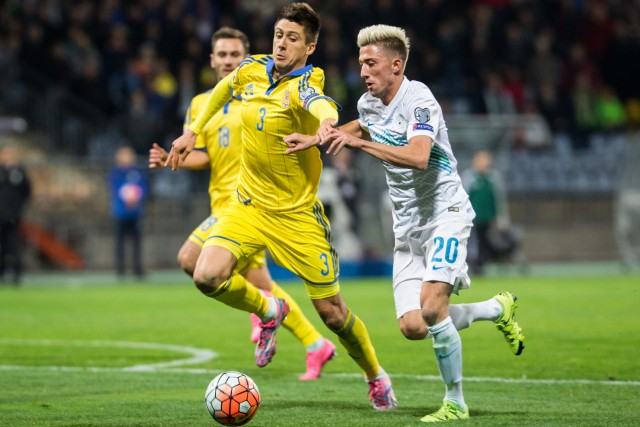 17 Nov 2015, Maribor, Slovenia --- Maribor, Slovenia. 17th November 2015 -- Yevhen Khacheridi (UKR) vs Kevin Kampl (SLO) during the UEFA EURO 2016 Play-off for Final Tournament, Second leg between Slovenia and Ukraine in Stadium Ljudski vrt, Maribor, Slovenia. -- Ukraine and Slovenia finish second qualifying match with score 1-1. Ukraine was better in final score after two games with 3-1 and celebrates qualifying on EURO 2016 in France.Played at Ljudski art Stadium ,Maribor, Slovenia --- Image by © Žiga Zupan/Demotix/Corbis