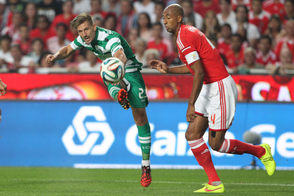 LISBON, PORTUGAL - AUGUST 31: Sporting's midfielder Adrien Silva kicks for the goal during the Primeira Liga match between SL Benfica and Sporting CP at Estadio da Luz on August 31, 2014 in Lisbon, Portugal. (Photo by Carlos Rodrigues/Getty Images).
